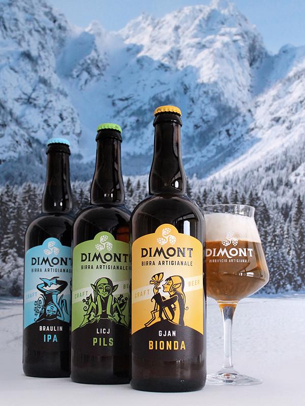 Una foto delle alpi con le birre Dimont in primo piano